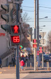 Red crossing light and pedestrians in the city Stock Photos