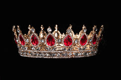 Red crown with red gems isolated on black background Royalty Free Stock Photos