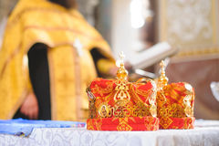 Red Crowns and Priest Stock Images