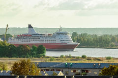 Red cruise ship. Passenger ferry sailing around the Riga city royalty free stock photography