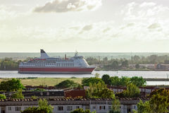 Red cruise ship. Passenger ferry sailing around the Riga city Stock Image