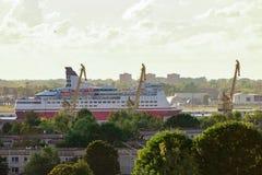 Red cruise ship. Passenger ferry sailing around the Riga city Stock Photo