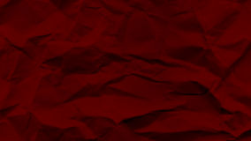 Red crumbled paper. Texture of a crumbled paper Royalty Free Stock Image