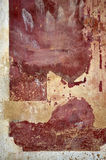 Red crumbled wall. Crumbled wall painted with red and beige Royalty Free Stock Photos