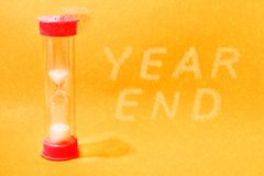 Free Red Crumbling Hourglass With Snowflake Text: The Year Is End Stock Images - 164381684