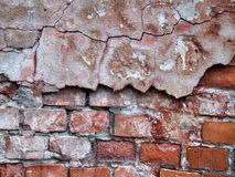 Red crumbling wall decay Stock Images