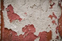 Red crumbling wall, old abandoned wall architecture. Background grunge design abstract retro house pattern vintage texture construction art dirty brown cement royalty free stock photos