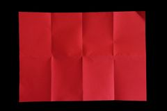 Red Crumple paper on black background Royalty Free Stock Photo