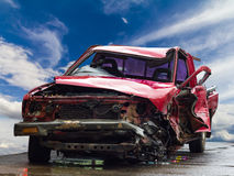 Red crumpled car wrecked. Royalty Free Stock Images