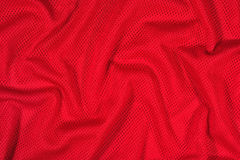 Red crumpled nonwoven fabric background Stock Photo