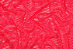 Red crumpled nonwoven fabric background Royalty Free Stock Photo