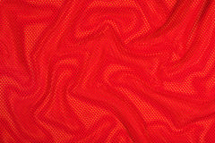 Red crumpled  nonwoven fabric on a yellow Stock Photo