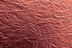 Red crumpled paper texture macro Stock Photography