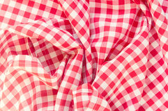Red crumpled picnic cloth background. Crumpled red picnic clothes background.Retro classic design fabric kitchen backdrop Stock Photo