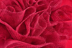 Red crumpled tulle close up Stock Photo