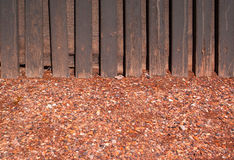 Red crushed gravel with wood wall Stock Photos