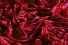 Red crushed velvet. Macro of red crushed velvet stock images