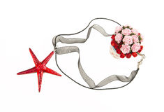 Red crystal star fish necklace with bush of roses Stock Photo