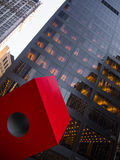 Red cube die in front of black facade Manhattan Downtown Skyscra. Per Royalty Free Stock Photo