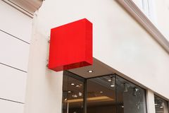 Red cube  logo sign on the wall Royalty Free Stock Image