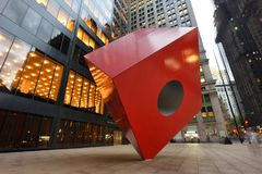 Red Cube Sculpture, NYC. Red Cube Sculpture on August 24, 2017 in New York City, USA. The sculpture is located in front of 140 Broadway, between Liberty and Stock Images