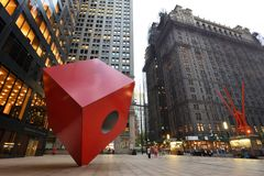 Red Cube Sculpture, NYC. Red Cube Sculpture on August 24, 2017 in New York City, USA. The sculpture is located in front of 140 Broadway, between Liberty and Royalty Free Stock Images