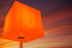 Red cube and sky Stock Photography