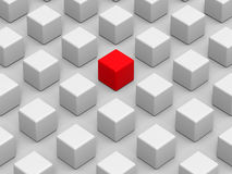 Red cube - standing out of the crowd. 3D render illustration of multiple cubes arranged in a rectangular pattern. One cube is colored in red indicating the one Royalty Free Stock Photos