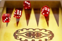 Red cubes against the background of a board for dicing royalty free stock images