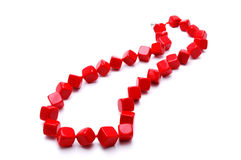 Red cubic beads on a white background Stock Photos