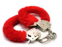 Red cuffs. Christmas cuffs Stock Image