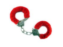 Red cuffs on white. Red hand cuffs on white Stock Photo
