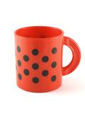 Red cup. Red with black spots cup isolated over white background royalty free stock photo