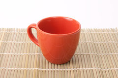 Red cup on bamboo Royalty Free Stock Images