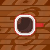 Red cup with black coffee on wood background. Stock Images
