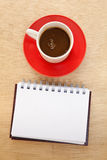 Red cup and book Stock Photography