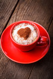 Red cup with cappuccino and heart Stock Image