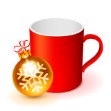 Red Cup and Christmas Ball Royalty Free Stock Image