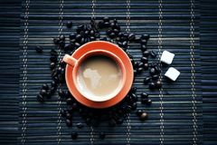 Cup of coffe with coffee beans stock image