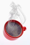 Red cup of coffee. Steaming cup of coffee - high angle view Royalty Free Stock Photography