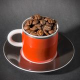Red Cup of Coffee Beans Stock Photos