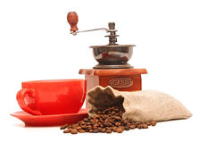 Red cup with coffee beans and old coffee mill Stock Photography