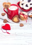 Valentine`s Day concept / red cup of coffee and biscuits shaped Stock Photography