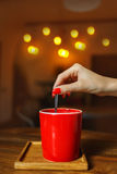Red cup of coffee in a cafe on table. Place for rest. Cup of coffee on wooden table, front view Stock Images