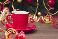Red cup of coffee , Christmas toys and streamers Stock Image