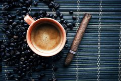 Cup of coffe with coffee beans and cigar royalty free stock images