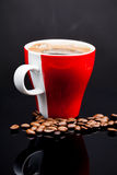 Red cup of coffee with coffee beans Stock Images