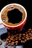 Red cup of coffee with coffee beans Royalty Free Stock Photo