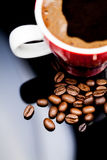 Red cup of coffee with coffee beans Stock Photography