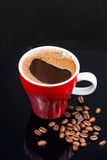 Red cup of coffee with coffee beans Stock Photo